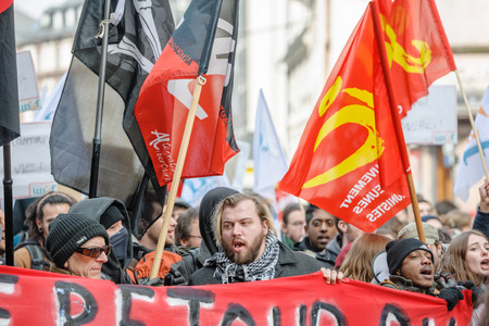 nationwide: STRASBOURG, FRANCE - 9 MAR 2016: Man yelling in front of crowd as thousands of people demonstrate as part of nationwide day of protest against proposed labor reforms by Socialist Government