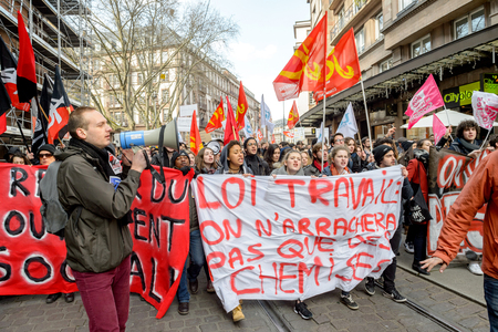 reforms: STRASBOURG, FRANCE - 9 MAR 2016: Closed city center as thousands of people demonstrate as part of nationwide day of protest against proposed labor reforms by Socialist Government