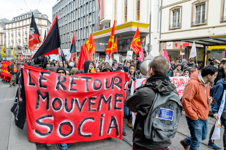 socialist: STRASBOURG, FRANCE - 9 MAR 2016: People blocking city center as part of nationwide day of protest against proposed labor reforms by Socialist Government