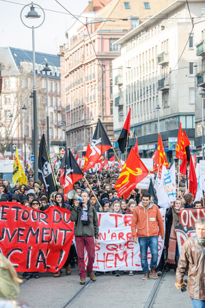 reforms: STRASBOURG, FRANCE - 9 MAR 2016: Blocked tramway lines and city ceter as thousands of people demonstrate as part of nationwide day of protest against proposed labor reforms by Socialist Government Editorial