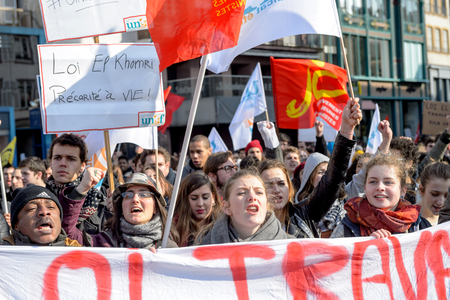 nationwide: STRASBOURG, FRANCE - 9 MAR 2016: Thousands of people demonstrate in Place Kleber as part of nationwide day of protest against proposed labor reforms by Socialist Government