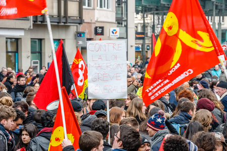 proposed: STRASBOURG, FRANCE - 9 MAR 2016: Against Macron Law placard as thousands of people demonstrate as part of nationwide day of protest against proposed labor reforms by Socialist Government