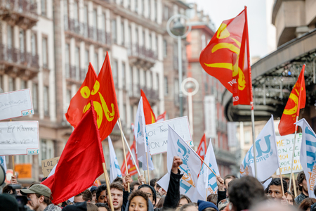 proposed: STRASBOURG, FRANCE - 9 MAR 2016:  Rised hand from crowd as thousands of people demonstrate as part of nationwide day of protest against proposed labor reforms by Socialist Government