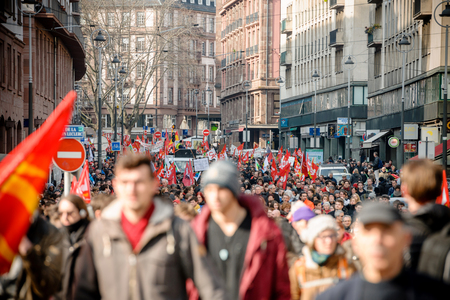 nationwide: STRASBOURG, FRANCE - 9 MAR 2016: Thousands of people demonstrate as part of nationwide day of protest against proposed labor reforms by Socialist Government in the center of Strasbourg