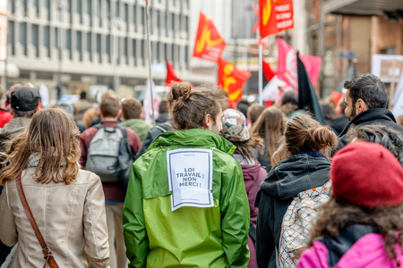 socialist: STRASBOURG, FRANCE - 9 MAR 2016: Work rule - no, thank you on back as thousands of people demonstrate as part of nationwide day of protest against proposed labor reforms by Socialist Government