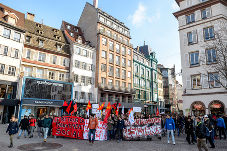proposed: STRASBOURG, FRANCE - 9 MAR 2016: Thousands of people demonstrate in Place Kleber as part of nationwide day of protest against proposed labor reforms by Socialist Government