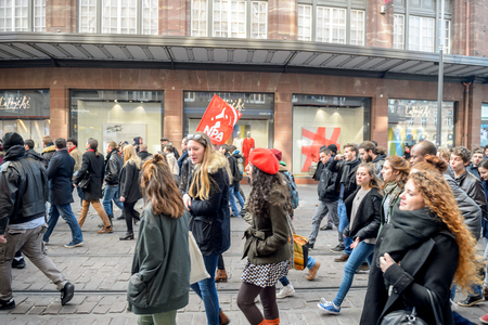 nationwide: STRASBOURG, FRANCE - 9 MAR 2016: Galeries Lafayette building and thousands of people demonstrate as part of nationwide day of protest against proposed labor reforms by Socialist Government