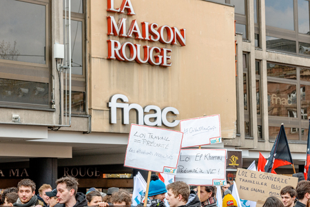 proposed: STRASBOURG, FRANCE - 9 MAR 2016: Labour law precarious placard as thousands of people demonstrate as part of nationwide day of protest against proposed labor reforms by Socialist Government Editorial