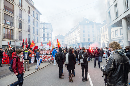 nationwide: STRASBOURG, FRANCE - 9 MAR 2016: Crowd blocking street as part of nationwide day of protest against proposed labor reforms by Socialist Government in the center of Strasbourg, france