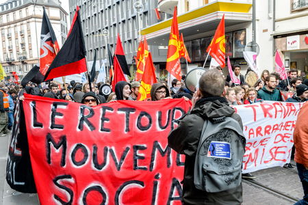 reforms: STRASBOURG, FRANCE - 9 MAR 2016: The return of Social Movement placard in front of thousands of people demonstrate as part of nationwide day of protest against proposed labor reforms by Socialist Government