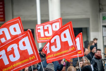 socialist: STRASBOURG, FRANCE - 9 MAR 2016: French communist flags as thousands of people demonstrate as part of nationwide day of protest against proposed labor reforms by Socialist Government Editorial