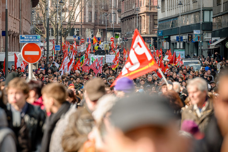 proposed: STRASBOURG, FRANCE - 9 MAR 2016: Thousands of people demonstrate as part of nationwide day of protest against proposed labor reforms by Socialist Government in the center of Strasbourg
