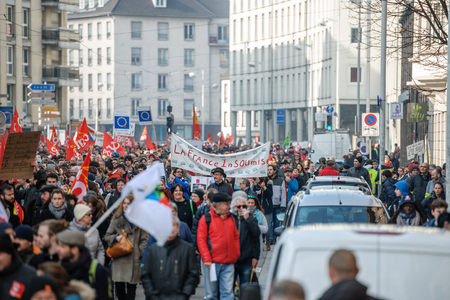 proposed: STRASBOURG, FRANCE - 9 MAR 2016: The Rebellious France placard as thousands of people demonstrate as part of nationwide day of protest against proposed labor reforms by Socialist Government
