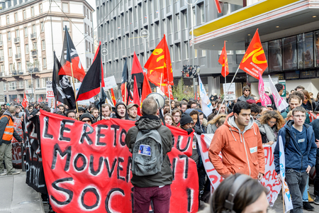 man yelling: STRASBOURG, FRANCE - 9 MAR 2016: Man yelling in megaphone as thousands of people demonstrate as part of nationwide day of protest against proposed labor reforms by Socialist Government