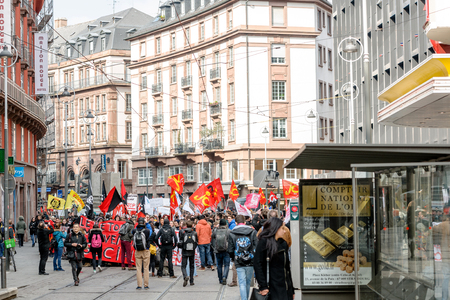 reforms: STRASBOURG, FRANCE - 9 MAR 2016: Photographers taking photos of thousands of people demonstrate as part of nationwide day of protest against proposed labor reforms by Socialist Government