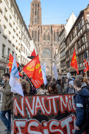 socialist: STRASBOURG, FRANCE - 9 MAR 2016: Thousands of people demonstrate in front of Strasbourg Notre-Dame cathedral as part of nationwide day of protest against proposed labor reforms by Socialist Government Editorial