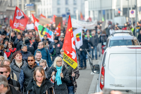 reforms: STRASBOURG, FRANCE - 9 MAR 2016: Large crowd perspective of thousands of people demonstrating as part of nationwide day of protest against proposed labor reforms by Socialist Government