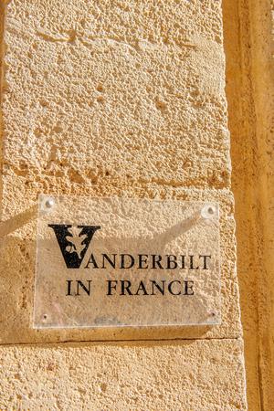 university sign: AIX-EN-PROVENCE, FRANCE - JUL 17, 2014: Vanderbilt in France University sign on typical Provence stone wall in the Provence city of Aix-En-Provence Editorial