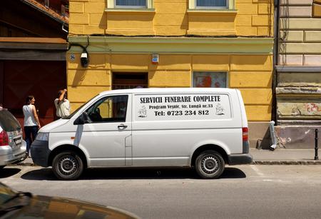 BRASOV, ROMANIA - JUL 5, 2015: Funeral service van on the streets of Brasov, Romania