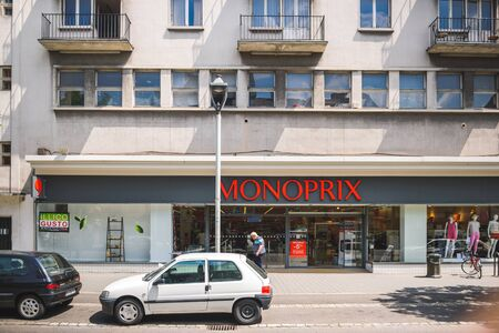 retail chain: STRASBOURG, FRANCE - MAY 23: Monoprix supermarket in the French city of Strasbourg on a warm spring day with customers entering and exiting store. Monoprix S.A. is a major French retail chain with its headquarters in Clichy, Hauts-de-Seine, France, near P Editorial