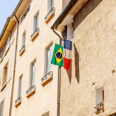 hanged: French and Brazilian flag hanged outside the window in the city of Marseille, town-city of Olympique Marseilles football club