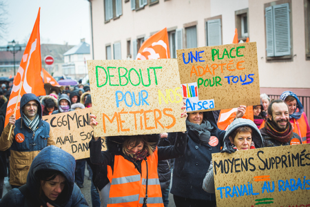 syndicate: STRASBOURG, FRANCE - MAR 15, 2016: Diverse placards as hundreds protests against Bas-Rhin Alsace departmental budget cuts for 2016, requesting no cuts and wage increase