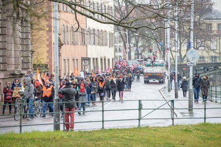 syndicate: STRASBOURG, FRANCE - MAR 15, 2016: Hundreds protests on Strasbourg streets under heavy rain against Bas-Rhin Alsace departmental budget cuts for 2016, requesting no cuts and wage increase Editorial