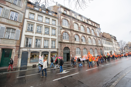 syndicate: STRASBOURG, FRANCE - MAR 15, 2016: Hundreds protests on Strasbourg streets against Bas-Rhin Alsace departmental budget cuts for 2016, requesting no cuts and wage increase