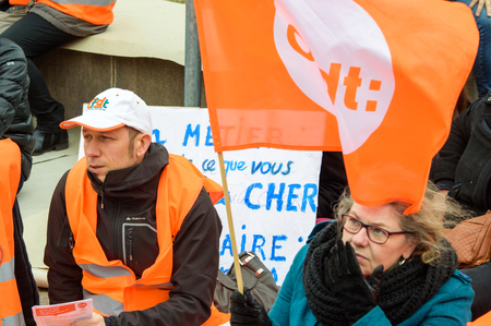 confederation: STRASBOURG, FRANCE - MAR 15, 2016: Confederation francaise democratique du travail die in protests against Bas-Rhin Alsace departmental budget cuts for 2016, requesting no cuts and wage increase