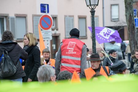 syndicate: STRASBOURG, FRANCE - MAR 15, 2016: no to austerity clothes sticker as hundreds protests against Bas-Rhin Alsace departmental budget cuts for 2016, requesting no cuts and wage increase