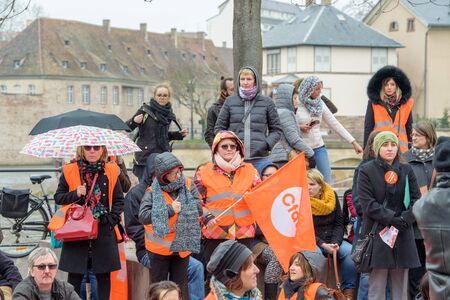 syndicate: STRASBOURG, FRANCE - MAR 15, 2016: Confederation francaise democratique du travail holding flags during protests against Bas-Rhin Alsace departmental budget cuts for 2016, requesting no cuts and wage increase Editorial