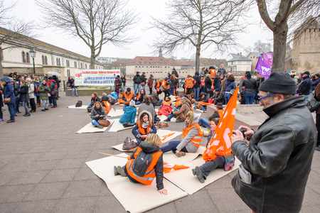 syndicate: STRASBOURG, FRANCE - MAR 15, 2016:  Die-in protest of hundreds protests against Bas-Rhing Alsace departmental budget cuts for 2016, requesting no cuts and wage increase