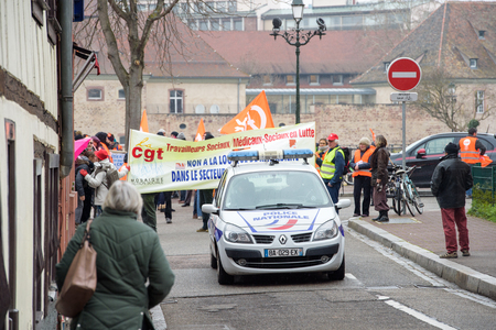 syndicate: STRASBOURG, FRANCE - MAR 15, 2016: Police surveilling crowd as hundreds protests against Bas-Rhin Alsace departmental budget cuts for 2016, requesting no cuts and wage increase Editorial