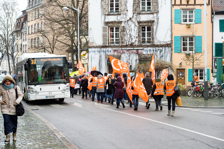 syndicate: STRASBOURG, FRANCE - MAR 15, 2016: Hundreds protests and bloking street on Strasbourg streets against Bas-Rhin Alsace departmental budget cuts for 2016, requesting no cuts and wage increase