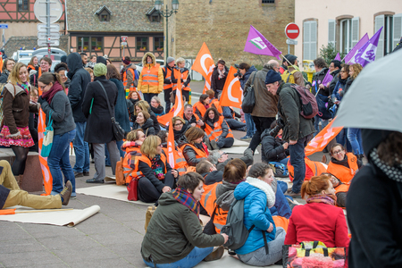 syndicate: STRASBOURG, FRANCE - MAR 15, 2016: Die-in of  hundreds protests against Bas-Rhing Alsace departmental budget cuts for 2016, requesting no cuts and wage increase Editorial