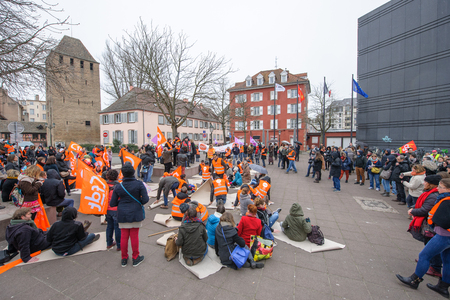 syndicate: STRASBOURG, FRANCE - MAR 15, 2016: Die-in protest as hundreds protests against Bas-Rhin Alsace departmental budget cuts for 2016, requesting no cuts and wage increase