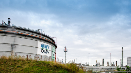 proceedings: VIENNA, AUSTRIA - CIRCA 2016: OMV - Osterreichische Minerallverwaltung white petrol tankers of the petroleum factory. OMV is an integrated international oil and gas company, headquartered in Vienna. It is active in the upstream (Exploration and Production Editorial