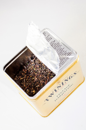 british foods: FRANKFURT, GERMANY - FEB 10, 2010: Twinnings Vintage Darjeeling opened tea box on white background. Twinings  is an English marketer of tea, based in Andover, Hampshire. The brand is owned by Associated British Foods. It holds the worlds oldest continual