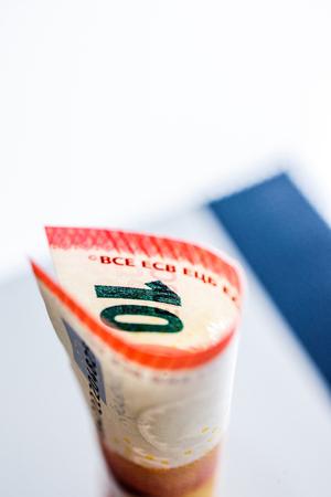 Ten Euro paper currency wraped in tubular shape