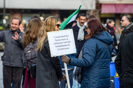 STRASBOURG, FRANCE - MAR 19, 2016: Woman holding as Syrian diaspora protesting in center of Strasbourg to denouncing the Syrian attacks and show solidarity with the Syrian people Editorial