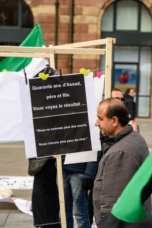 STRASBOURG, FRANCE - MAR 19, 2016: 40 years of Assad - you see the result placard as Syrian diaspora protests in center of Strasbourg to denouncing the Syrian attacks and show solidarity with the Syrian people Editorial