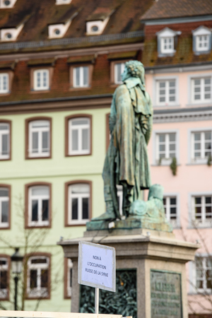 STRASBOURG, FRANCE - MAR 19, 2016: General Kleber statue and No to Russian Occupation placard as Syrian diaspora protests in center of Strasbourg to denouncing the Syrian attacks and show solidarity with the Syrian people