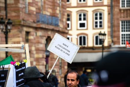 STRASBOURG, FRANCE - MAR 19, 2016: No to russian occupation placard as Syrian diaspora protests in center of Strasbourg to denouncing the Syrian attacks and show solidarity with the Syrian people