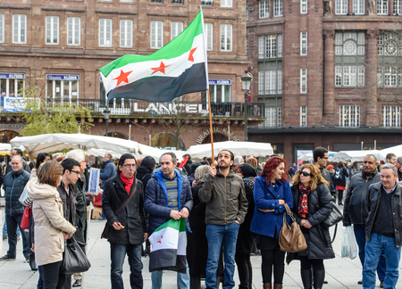 al assad: STRASBOURG, FRANCE - MAR 19, 2016: Syrian diaspora protests in center of Strasbourg to denouncing the Syrian attacks and show solidarity with the Syrian people Editorial