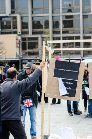 al assad: STRASBOURG, FRANCE - MAR 19, 2016: People debating as Syrian diaspora protests in center of Strasbourg to denouncing the Syrian attacks and show solidarity with the Syrian people Editorial