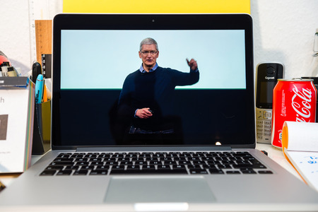 to and fro: PARIS, FRANCE - MARCH 21, 2016: Apple Computers website on MacBook Pro Retina in a creative room environment showcasing Apple Event with Tim Cook saying thank you for coming