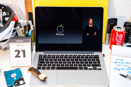 programm: PARIS, FRANCE - MARCH 21, 2016: Apple Computers website on MacBook Pro Retina in a creative room environment showcasing Apple Event with Lisa Jackson amd Renew recycle programm Editorial
