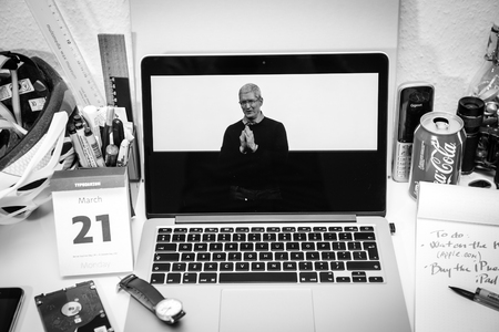 thanking: PARIS, FRANCE - MARCH 21, 2016: Apple Computers website on MacBook Pro Retina in a creative room environment showcasing Apple Event with Tim Cook thanking