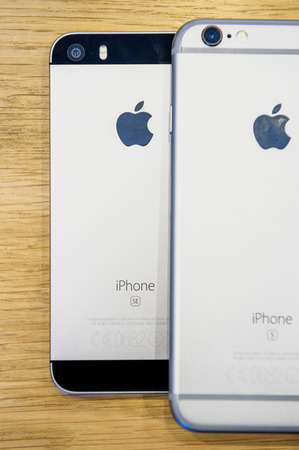 comparing: PARIS, FRANCE - APR 4, 2016: Comparing iPhone 6S next to the new Apple iPhone SE during the sales launch of the latest Apple Inc. smartphone and iPad Pro at the Apple store in Paris, France Editorial