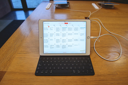 retina display: PARIS, FRANCE - APR 4, 2016: Calendar app with monthly overview on  the new Apple iPAd Pro during the sales launch of the latest Apple Inc. smartphone and iPad Pro at the Apple store in Paris, France
